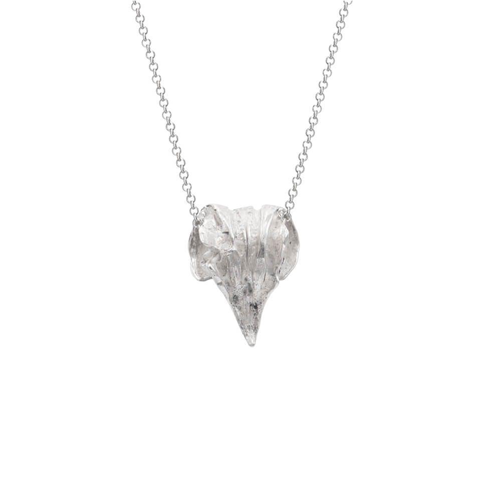 Silver handmade pendant in shape in eagle's beak