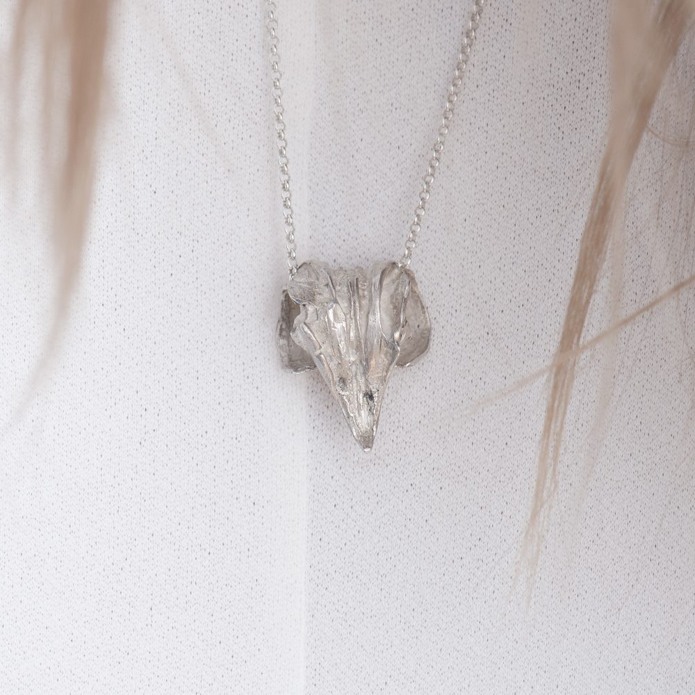 Detailed pendant of an eagle's beak on a necklace