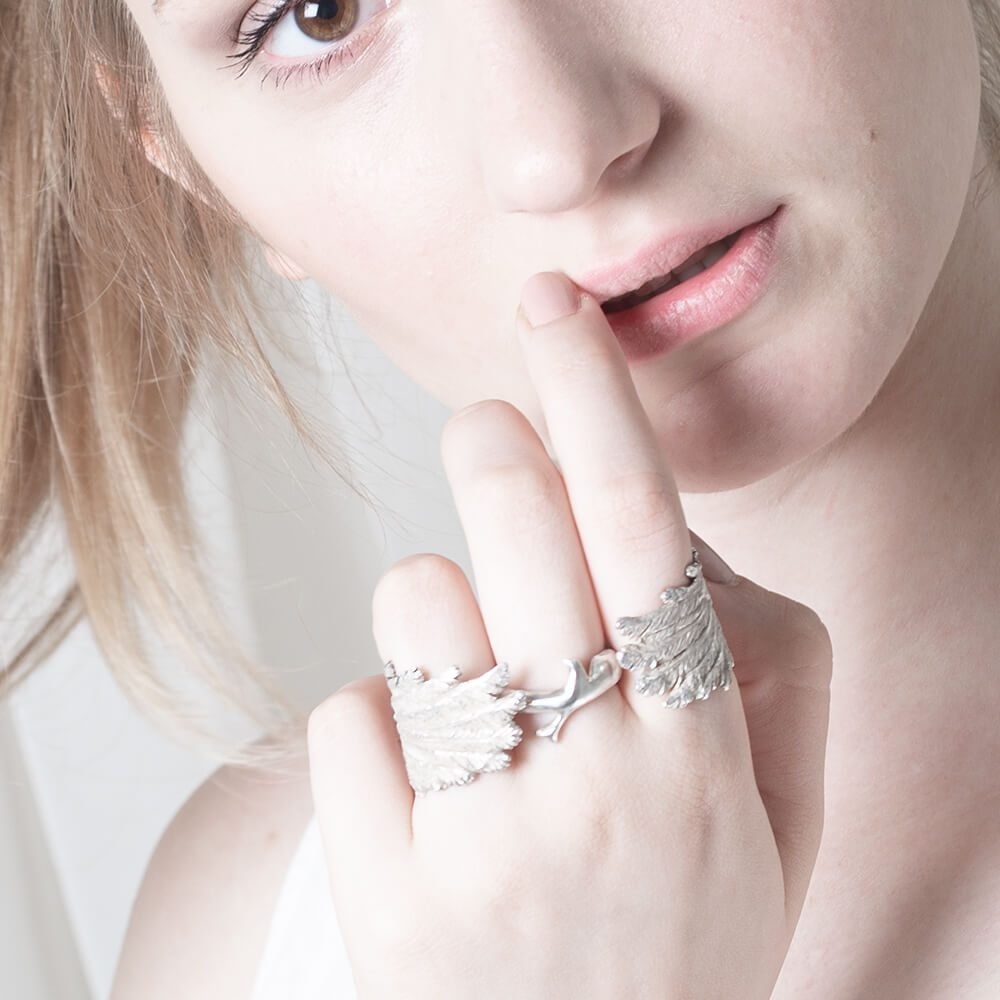 Handmade and unique statement ring of a bird with angle wings