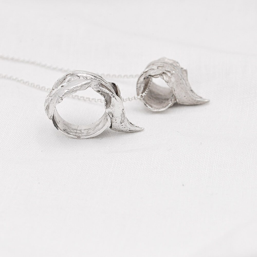 Complementary jewellery set of beak necklace and ring