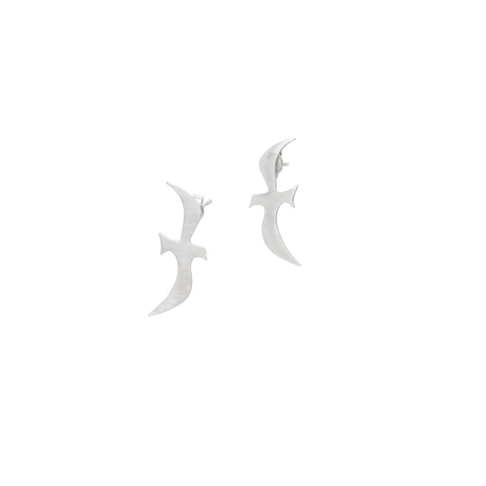 Sterling silver earrings set in shape of little swallow birds, each flying in different direction