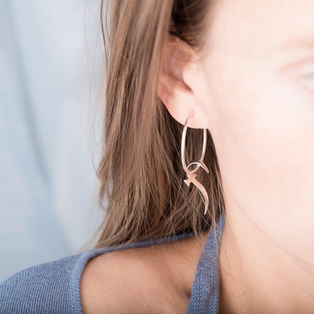 Sterling silver hanging bird earring look