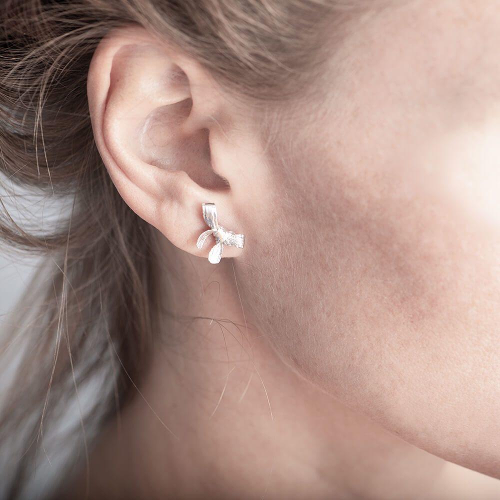 Bow earring, right ear