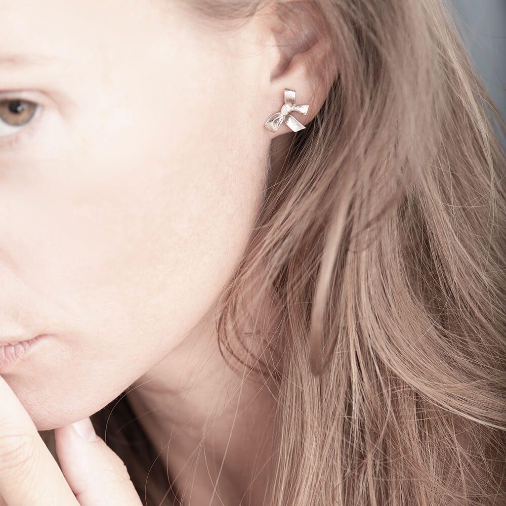 Bow earring, silver, left ear