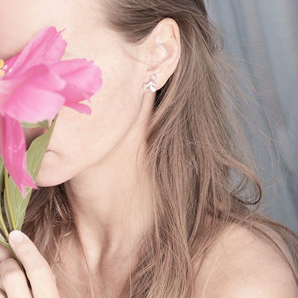 Stud earrings, bow design