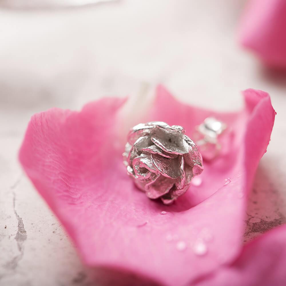 Silver rose stud earrings